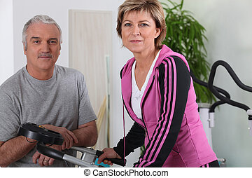 Married couple working out in a gym