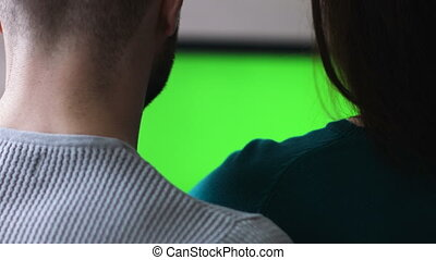 Married people and technology, young man and woman using laptop pc with green screen for internet and email at home. Dolly shot