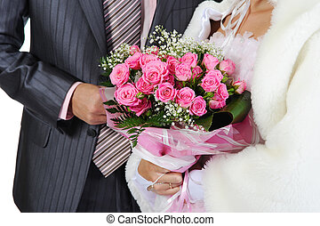 Married with a bouquet of pink roses. Isolated on white...