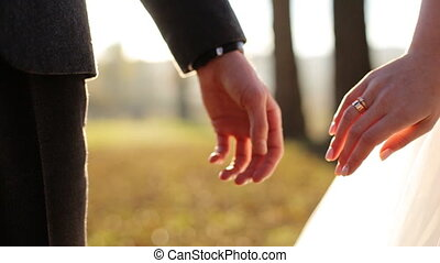 Marry me today and everyday. Newlywed couple holding hands,...