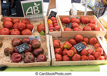 MARSEILLE, FRANCE - JULY 28, 2017  :  Tomatoes certified AB (Organic Agriculture) on a market, France, Provence, summer