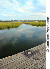 Marsh landscape 2 - Marsh wetlands with a pier in the...