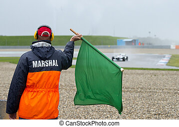Marshal waving a green flag