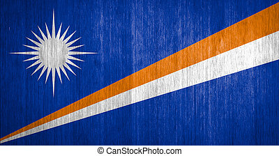 Marshall Islands Flag on wood background