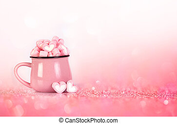 marshmallow heart shape on pink background with love concept