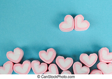 marshmallow heart shape with love concept on blue background
