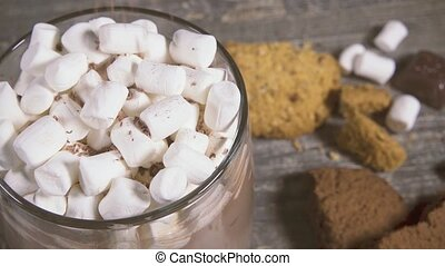 Marshmallow in a mug with a drink sprinkle with chocolate -...