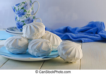 Marshmallow in a plate on a white background - White vanilla...