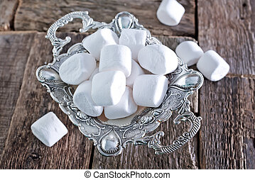 marshmallow on metal tray and on a table