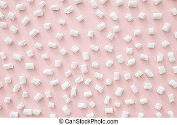 Marshmallow pattern on pastel pink background. Flat lay, top view, copy space. Winter concept.