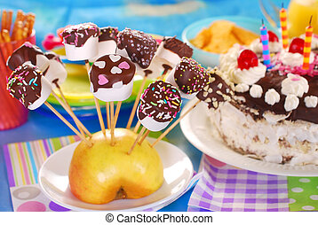 marshmallow pops with chocolate and colorful sprinkles for...