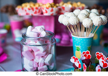 Marshmallow, sweet colored meringues, popcorn, custard cakes...