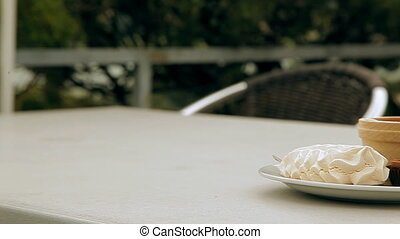 Marshmallows and milk on the table in the dish