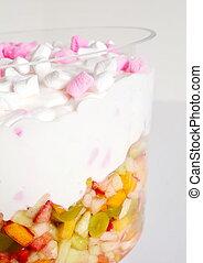Marshmallows in cream over fruit salad