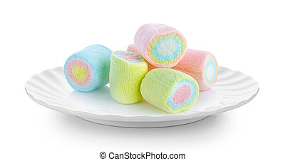 marshmallows in white plate on white background