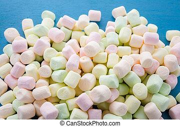 Marshmallows - Small round multicolor marshmallows on blue...