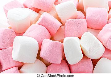 Marshmallows - Round white and pink marshmallows on a white...