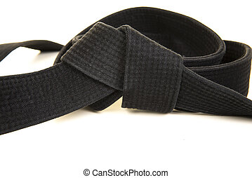 Martial art black belt in a knot on a white background