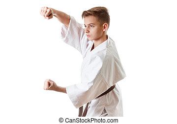 Martial art sport karate - child teen boy in white kimono...