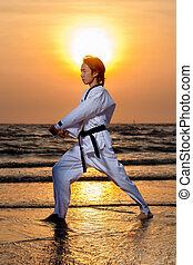 Martial art training on beach
