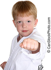 Martial Arts Boy - Boy making karate punch towards camera. ...
