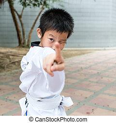 martial arts boy in kimono excercising karate kata