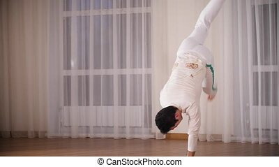 Martial arts. Capoeira. A professional acrobatic man...