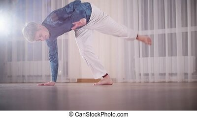 Martial arts. Capoeira. A professional man performs an...