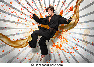 Martial arts expert mid air on linear pattern with orange...