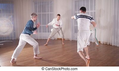 Martial arts. Four acrobatic man doing a turnover in a circle