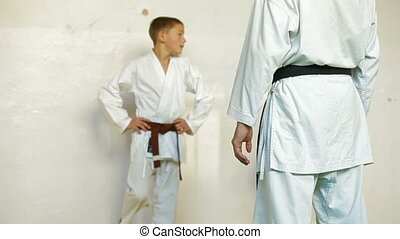 Martial arts instructor training children in gym