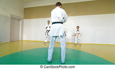 Martial arts instructor training  students in gym