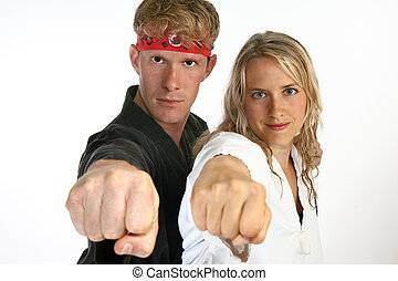 Martial arts man and woman punching