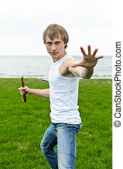 Martial arts: Man with nunchaku