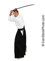 Martial arts - Mid-adult man dressed in traditional kimono...