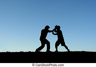Martial arts - Two men practicing martial arts on top of a ...