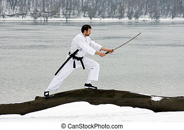 martial arts with sword at winter