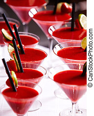 Martini glases with red drinks. close-up image