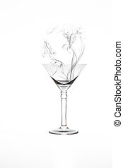 Martini glass with artificial smoke in it isolated on white background