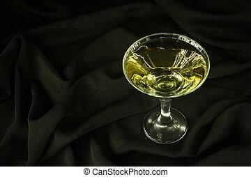 Martini on black cloth