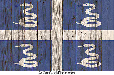 Martinique Flag on wood background