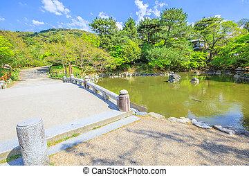 Maruyama Park Kyoto - Stone bridge and pond in Maruyama...