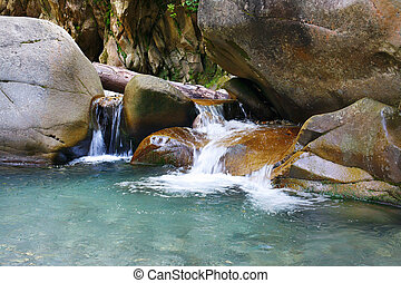 Marvellous refreshing waterfalls on mountain stream -...