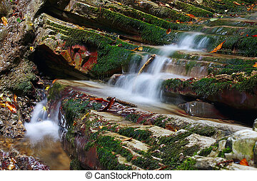 Marvellous rocks with moss and flowing streams of the...