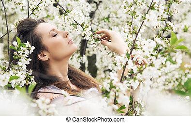 Marvelous brunette relaxing in the ochard - Marvelous...