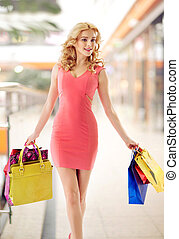 Marvelous lady walking with shopping bags - Marvelous woman...