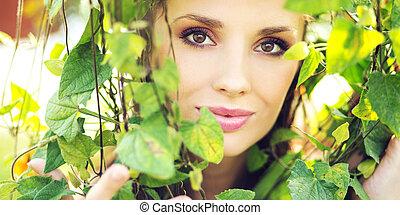 Marvelous woman among the greenery