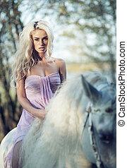 Marvelous woman riding a horse