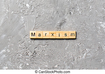 marxism word written on wood block. marxism text on table, concept
