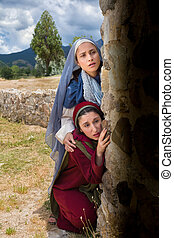Mary and Mary Magdalene looking into the empty tomb